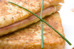 Toasted cheese and ham sandwiches with chives Royalty Free Stock Photo