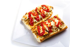 Toasted cheese and meat baguette stock image