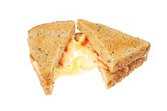 Toasted cheese sandwich. Toasted emmental cheese, ham and tomato sandwich isolated against white Stock Photo