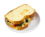 Toasted chicken sandwich on plate Stock Images