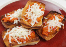 Toasted ciabatta with topping Stock Photo