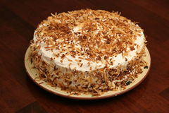 Toasted coconut cake whole wood Royalty Free Stock Photos