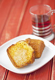 Toasted corn muffin with butter and a cup of tea Royalty Free Stock Photos