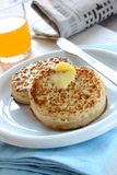 Toasted Crumpets. Toasted butter crumpets in a tabletop setting stock image