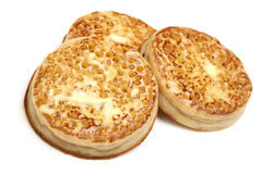Toasted Crumpets with Butter Isolated on White Stock Photo