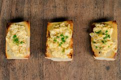 Toasted french loaf with scramble egg Stock Images