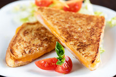 Toasted ham and cheese sandwich. Royalty Free Stock Images