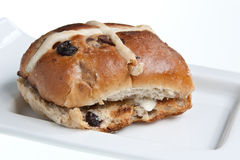 Toasted Hot Cross Bun. A traditional hot cross bun, toasted & buttered Stock Photography