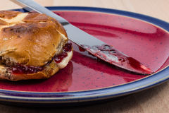 Toasted Hot Cross Bun on Plate Royalty Free Stock Images