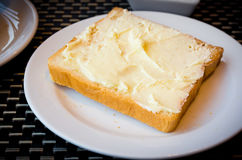Toasted and margarine. Close up shot of toasted and margarine   image Royalty Free Stock Photo
