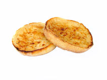 Toasted muffins. Toasted golden muffins buttered stock image