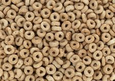 Toasted oat cereal top close view. Top view of a portion of dry toasted oat breakfast cereal royalty free stock image