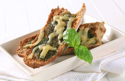 Toasted pesto bread with cheese Royalty Free Stock Image