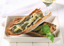 Toasted pesto bread with cheese Stock Images