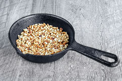 Toasted pine nuts in a pan Stock Image