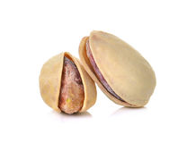 Toasted pistachios on a white background Stock Images