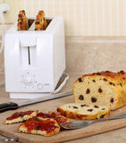 Toasted Raisin Bread. With jam on a kitchen counter Royalty Free Stock Images