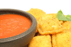 Toasted ravioli with marinara. Isolated photo of toasted ravioli with marinara sauce on white Royalty Free Stock Photo