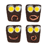 Toasted rye bread with funny faces Stock Photos