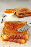 Toasted sandwich. With some organic orange marmalade Royalty Free Stock Image