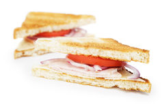 Toasted sandwich with ham, cheese and vegetables Royalty Free Stock Images