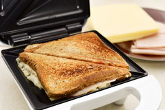 Toasted sandwiches in a sandwich toaster Royalty Free Stock Images