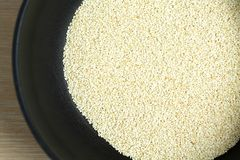 Toasted sesame seeds in a frying pan. Fried sesame seed close-up. royalty free stock images