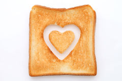 Toasted slice of bread. With hole heart shape Stock Photos