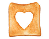 Toasted slice of bread. With hole heart shape Royalty Free Stock Image