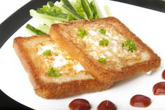 Toasted white bread with an egg Stock Photography