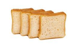Toasten Sie das Weizenbrot geschnitten lokalisiert auf weißem Hintergrund Stockbild