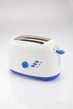 Toaster. Blue and White electric toaster Royalty Free Stock Photos