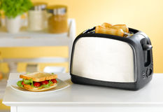 Bread toaster in the kitchen. Fast and convenience to make sandwich with bread toaster an image isolated in the kitchen interior Stock Photography