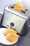 Toaster. And two crispy toast on a plate Stock Images