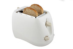 Toaster. The device for preparation of hot toasts and two pieces of bread in it Stock Image