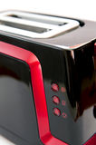 Toaster details. Close-up of the shiny red and black toaster Stock Photos