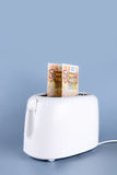 Toaster and euro Stock Photo