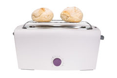 Toaster and fresh baked buns. For breakfast. Stock Photo