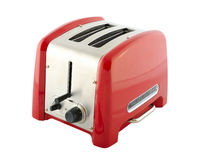 Toaster. Kitchen appliances - toaster of silver and red color, isolated on a white background Stock Image