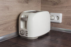 Toaster on the kitchen table. Kitchen appliances Stock Photography