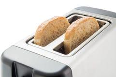 Toaster mit Brotscheiben Lizenzfreie Stockfotos