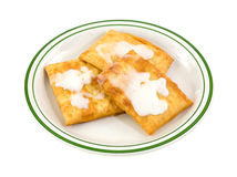 Toaster pastries with icing on a plate Stock Photos