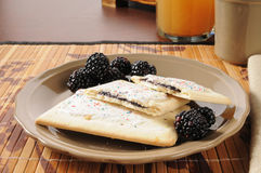 Toaster tarts with blackberries Royalty Free Stock Photo