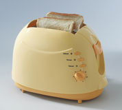Toaster with toast Royalty Free Stock Photography