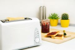 Toaster and toast with jam in modern kitchen Stock Image