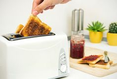 Toaster and toast with jam in modern kitchen Stock Photo