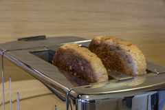 Toaster with toasted bread Stock Images