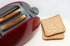 Toaster with toasted bread on white background, Kitchen equipment. Close up. Side view stock photo