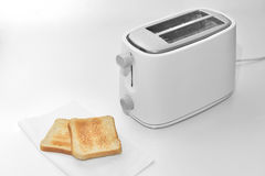Toaster with two slices of bread stock images