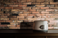 Toaster on wooden cupboard in kitchen room Stock Photos